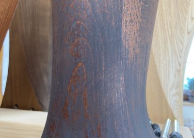 Patina on beech wood stained to mahogany
